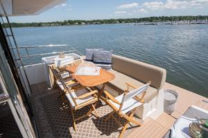 51' Sealine C48 2013 Aft Deck with storable teak table and chairs