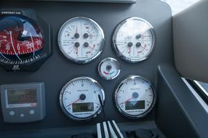 51' Sealine C48 2013 Volvo analog gauges, quick chain counter, and magnetic compass