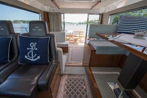 51' Sealine C48 2013 Aft facing view from raised Helm station and settee