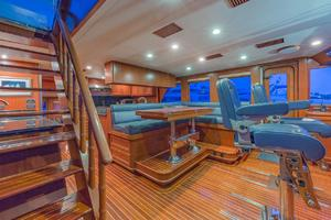 76' Alaskan 75 Pilothouse 2008 Helm seating and convertible dining table