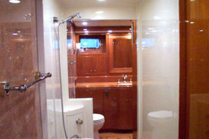 76' Offshore Yachts Motoryacht 2010 His & Her's Master Bath with Walk-Thru Shower