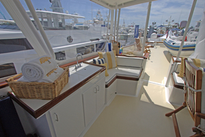 102' Palmer Johnson Cockpit Motoryacht 1980 Flybridge Seating Area