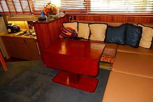 46' Bertram Motor Yacht 1974 Beautiful teak hi low dining table
