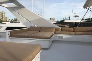 100' Broward Raised Pilothouse 2000 Flybridge - aft seating and sun lounge port