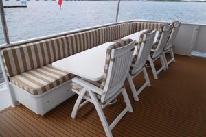 100' Broward Raised Pilothouse 2000 Aft Deck Seating and Dining