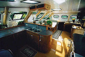 65' Woodwind Kurt Hughes Custom Ca  1999 GalleySaloon