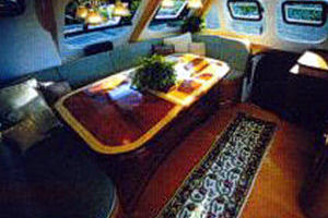 65' Woodwind Kurt Hughes Custom Catamaran  1999 Dinette/Saloon