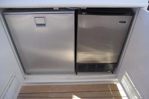 52' Buddy Davis Express 2002 Helm Deck Refrigerator and Icemaker