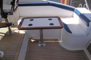 52' Buddy Davis Express 2002 Helm Deck Seating and Table