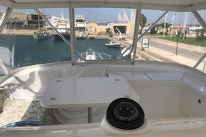63' Bertram Convertible 2007 Flybridge Forward Seating and Table