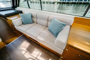 50' Riviera 50 Enclosed Bridge 2015 Settee with table folded down