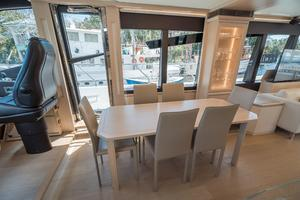 72' Absolute 72 2016 Dining Table Forward with Stbd Door