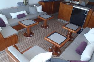 72' Mangusta 72 2006 Cockpit lounge with hi/lo tables