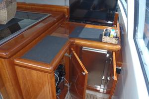 72' Mangusta 72 2006 Cockpit entertainment ctr & refrigerator