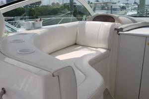 39' Cruisers Yachts 3970 Express Hardtop 2003 Cockpit seating port side forward