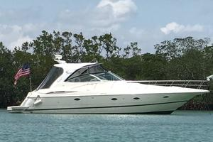 39' Cruisers Yachts 3970 Express Hardtop 2003 Starboard Side At Anchor