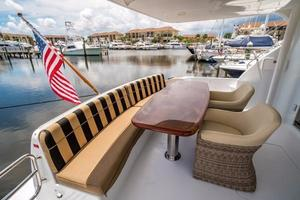 64' Hatteras 64 Motor Yacht 2006 Huge aft deck gloss wood table
