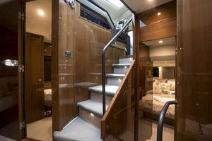 62' Princess V62-S 2015 Steps leading down the salon/staterooms