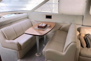 44' Cruisers Yachts 4450 2002 Dinette Looking Starboard
