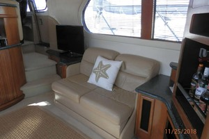 45' Carver 450 Voyager Pilothouse 1999 Starboard Cabin Loveseat Opens to a Small Bed