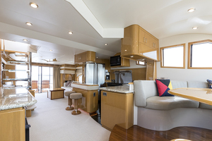 69' Marquis 65 Skylounge 2008 Galley/salon looking aft
