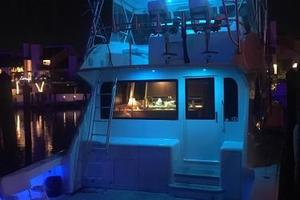 55' Viking Convertible 2000 Beautiful Blue Lights at Night.
