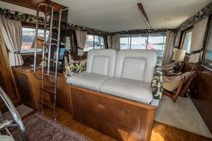 54' Hatteras 54 Motor Yacht 1988 Helm Seating and Flybridge Stairs