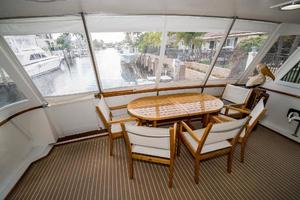 63' Hatteras 63 Cockpit Motor Yacht 1987 Aft Deck Table