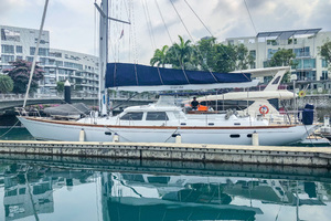 73' Sensation Yachts  1997 Opus 73 port side in marina