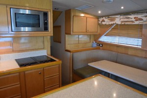 60' Bertram 60 Convertible 1998 Galley and Dinner Table View