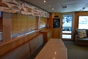 60' Bertram 60 Convertible 1998 Dinner Table to Salon TV