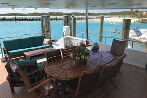 105' Broward Custom Extended 1990 Aft Deck Dining