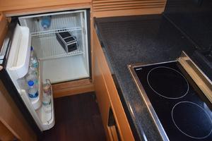 43' Azimut Flybridge Motor Yacht 2007 Galley refrigerator, also a freezer in cabinet behind door
