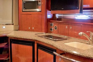 39' Sea Ray 390 Sundancer 2005 3 Galley with TV flipped down