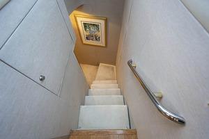50' Lazzara Skylounge 2001 Forward Stairwell to Crew Quarter