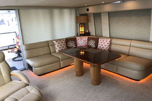 65' Pacific Mariner Pilothouse 2000 Main Salon with Hi-Lo Cocktail / Dining Table
