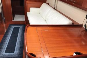 49' Beneteau America 49 2007 Starboard settee with leather upholstery
