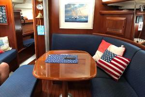 43' Beneteau America 423 2004 Main cabin, table can be converted to a large bed