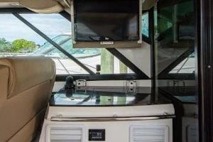 42' Regal 42 Sport Coupe 2013 Helm Deck Grill Area with TV