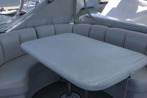 59' Marquis Flybridge Motor Yacht 2004 Flybridge Table Covered