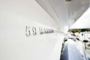 59' Marquis Flybridge Motor Yacht 2004 StbdSideDeckLogo