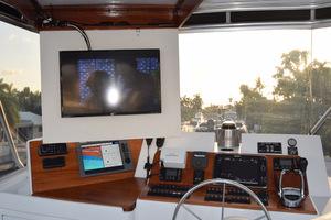 78' Hatteras Cockpit Motoryacht 1989 Upper Helm With TV Cabinet Open