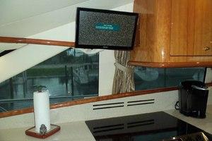 62' Neptunus Cruiser 2004 Lower Helm Chair on Galley TV