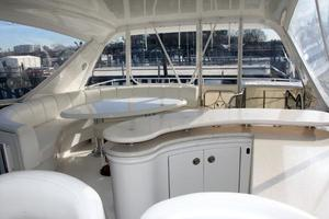 65' Marquis 65 Motor Yacht Skylounge 2006 Dining Table and Wet Bar with Storage
