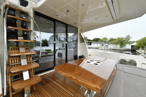 55' Prestige 550 Flybridge 2016 Cockpit with Seating and Solid Wood Table
