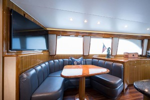 """64' Viking Sportfish 2007 Dinette and Sony 42"""" Flat Screen with Large Storage Behind TV"""