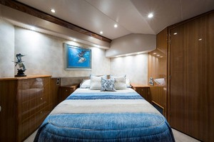 64' Viking Sportfish 2007 Master Stateroom with Queen Bed (on angle) and Storage Under