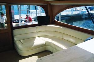 57' Spencer Sportfish 2013 Salon w/custom L-shaped Sofa with Gas Rams to Acce