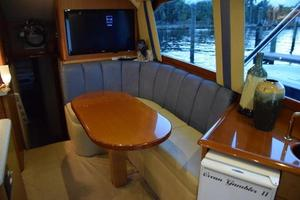 48' Ocean Yachts  2003 Dinette and Teak table, flat panel TV