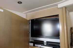 52' Hatteras Convertible 1986 TV Cabinet Open